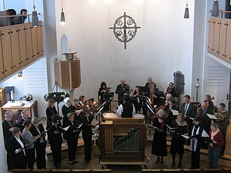 Authenticity in art - An ensemble performing Baroque music with authentic instruments and techniques, but in modern dress and setting.