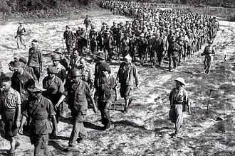 Battle of Dien Bien Phu - Captured French soldiers from Dien Bien Phu, escorted by Vietnamese troops, walk to a prisoner-of-war camp