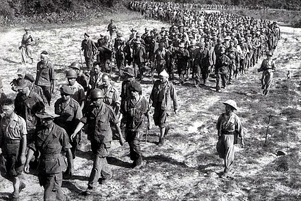 Captured French soldiers from Dien Bien Phu, escorted by Vietnamese troops, 1954 Dien Bien Phu 1954 French prisoners.jpg