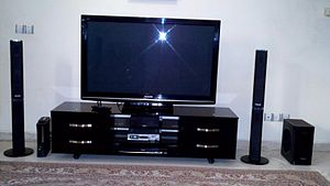 Home theater in a box - A mid-priced Panasonic Home Theatre in a Box package, which consists of the DVD player, which contains an integrated multi-channel power amplifier, and a set of speakers. The consumer must buy the television and stand separately.