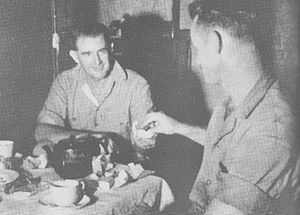 Donald Gilbert Kennedy - Donald Kennedy (left) serves tea to U.S. Marine Captain Clay Boyd (1943)