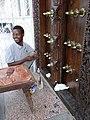 Door Painter - Stone Town - Zanzibar - Tanzania (8841052635).jpg