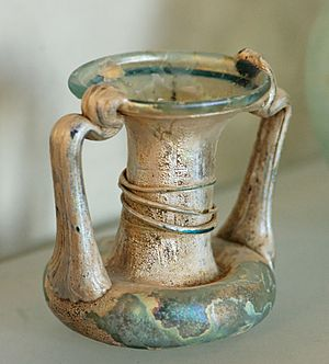 Roman glass - A double-handled glass vial from Syria, c. 4th century AD