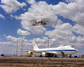 Boeing E-4 - A right front view of an E-4 advanced airborne command post (AABNCP) on the nuclear electromagnetic pulse (EMP) simulator for testing.
