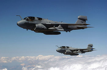 Two US Navy (USN) EA-6B Prowler aircraft fly a...