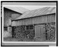 EXTERIOR, WEST SIDE SHOWING DOORWAY AND MASONRY WALL - Wood Block Masonry Barn, No. 1, Lena, Oconto County, WI HABS WIS,42-LENA,1-2.tif
