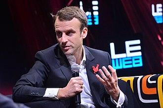 Radical centrism - Emmanuel Macron speaking at a high-tech conference, 2014.