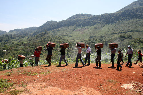 Ixil Maya carrying exhumed bodies of their relatives killed in the Guatemalan Civil War Exhumation in the ixil triangle in Guatemala.jpg