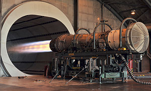 Jet engine - A Pratt & Whitney F100 turbofan engine for the F-15 Eagle  being tested in the hush house at Florida Air National Guard base. The tunnel behind the engine muffles noise and allows exhaust to escape.
