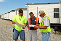 FEMA - 37135 - Checking mobile homes at at staging area in Iowa.jpg