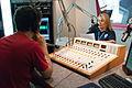 FEMA - 43958 - FEMA worker reading a public radio announcement in New Jersey.jpg