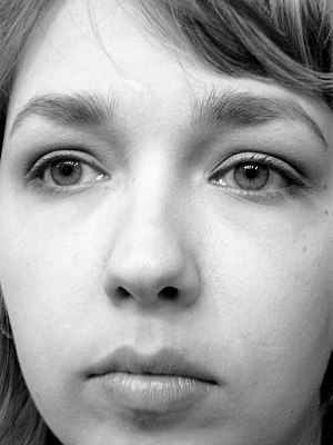 Blank expression - A woman with a neutral expression