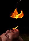 Fire Eater Performing Dragons Breath Trick.jpg