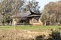 Fire damaged house on the NSW side of the Murray River, viewed from Gateway Island.jpg