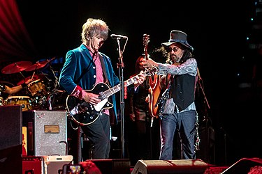 Neil Finn (left) and Mike Campbell (right) performing with Fleetwood Mac in 2018. Both joined the band following Lindsey Buckingham's departure that same year FleetMacTulsa031018-71 (45183773542).jpg