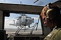 Flickr - Official U.S. Navy Imagery - A Navy officer acts as a landing safety officer during the retrieval of a helicopter..jpg