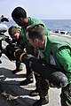 Flickr - Official U.S. Navy Imagery - Sailors remove a Hellfire missile..jpg
