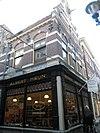 foto van Winkelwoonhuis met bijbehorend pakhuis
