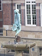 Fountain with a woman and a harp, outside the Cadbury Factory (6204210282).jpg