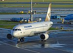 Freebird Airlines A320 (TC-FBH) Gold tail color at Amsterdam Airport Schiphol (EHAM) - 2.jpg