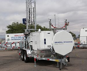 General Dynamics Mission Systems - General Dynamics Mission Systems Deployable 4G LTE Cell on Wheels (COW) parked outside the New Mexico State Fair.