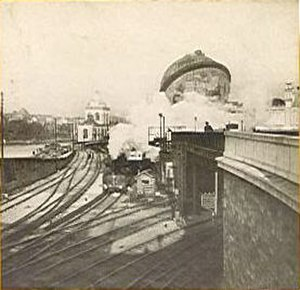 Gare du Champ de Mars - The 1900 station with the Celestial Globe in the background.