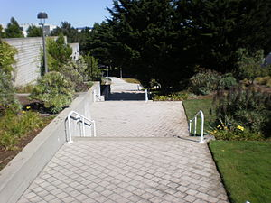 A walkway through the mid campus of the Genent...