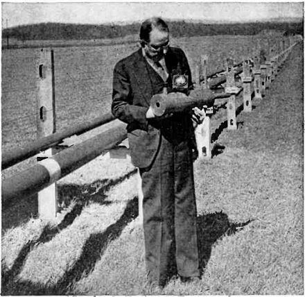 George C. Southworth who developed waveguides in the early 1930s, in front of mile-long experimental waveguide run at Bell Labs, Holmdel, New Jersey, used in his research George Southworth & waveguides.jpg