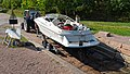 Getting the boat out of the water 6 - Boat on the trailer on dry land, ready to be towed by a car.jpg