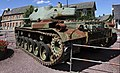 Giverville, France. WW2 items and militaria from a commemorative exhibition on the liberation 1944. M26 Pershing WWII tank on the market place. 2015.jpg