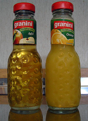 Granini apple and orange juice bottles
