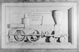 4-4-0 - 1856 relief sculpture of a 4-4-0 commissioned by the Norris Locomotive Works, depicting an early model prior to the adoption of the covered cab