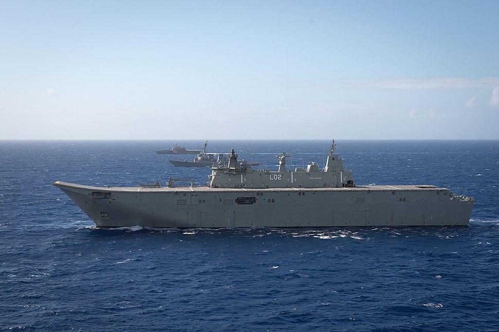 HMAS Canberra sailing in formation at RIMPAC 2016