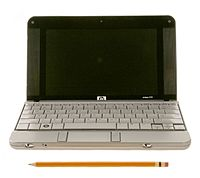HP 2133 Mini-Note PC netbook (front view compare with a pencil)