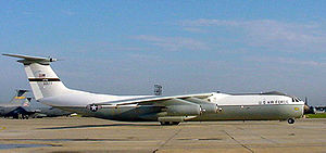 Military Airlift Command - C-141B, AF Ser. No. 66-0177, the Hanoi Taxi, after 2002 repainting to revert to 1970s scheme. Note the stretched fuselage indicating its modification from its earlier C-141A configuration to the C-141B configuration. Other C-141Bs with the standard USAF paint scheme of 2006 can be seen in the background.