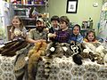 Happy kids pose with some animal furs (17036439038).jpg