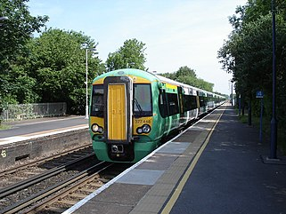 Hassocks Station - train arriving from London - geograph.org.uk - 1169890.jpg