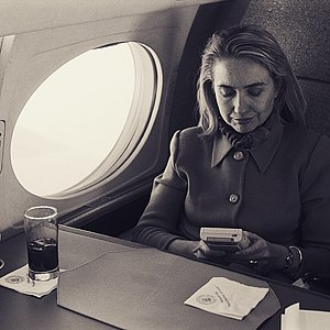 Gamer - Hillary Clinton playing a Nintendo Game Boy video game on a flight