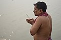 Hindu Devotee Prays To Sun And Ganga With Incense - Makar Sankranti Observance - Howrah 2018-01-14 6941.JPG