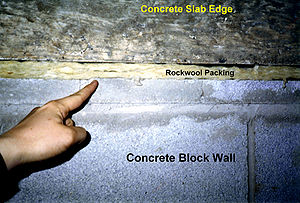 Mineral wool - Building joint with incomplete firestop made of mineral wool packing that still requires topcaulking.