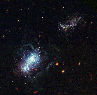 Chronology of the universe - Another Hubble image shows an infant galaxy forming nearby, which means this happened very recently on the cosmological timescale. This shows that new galaxy formation in the universe is still occurring.