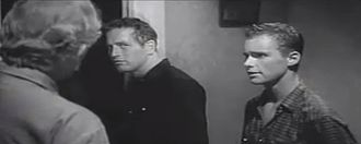 Hud (1963 film) - Homer confronts Hud, as Lonnie looks on