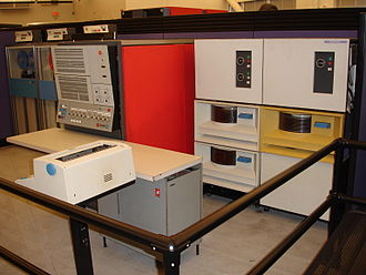 IBM System/360 - IBM System/360 Model 30 CPU (red, middle of picture), tape drives to its left, and disk drives to its right, at the Computer History Museum