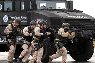 U.S. Immigration and Customs Enforcement - HSI Special Response Team (SRT) members training using armored vehicle at Fort Benning in Georgia.