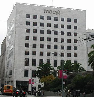 Timothy L. Pflueger - The Macy's complex at Union Square includes this building which was once I. Magnin's flagship location. The flat face of white stone and plate glass, an example of International style, was Pflueger's final work, completed in 1948.