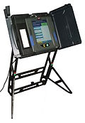 From commons.wikimedia.org: Electronic voting machine--infinitely hackable. {MID-70909}