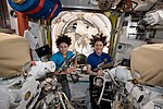 Jessica Meir and Christina Koch inside the Quest airlock.jpg