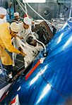 Jim Lovell,the Back-up Commander, slides into the Command Module for an altitude chamber test.jpg