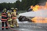 Joint Base Andrews Fire Explorer Academy cadets test hose lines.jpg