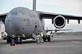 Josh Michal, with the U.S. Defense Attache Office, ascends the stairs to the crew-entry door on a U.S. Air Force C-17 Globemaster III aircraft Nov. 11, 2013, during Kiwi Flag as part of Southern Katipo 2013 131111-F-FB147-072.jpg